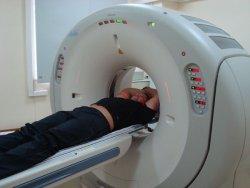 КТ исследование в компьютерном томографе, КТ, рентгеновская компьютерная томография, мультиспиральный томограф